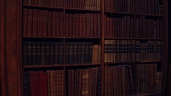 Uncognizable old books. 4K pan video Stock Footage