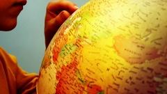 Globe and Child Hands - Mediterranean - 4k Stock Footage