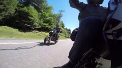 Amazing motorcycle pov rider salutes camera Stock Footage