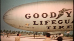 "Goodyear Blimp ""Lifeguard Tires"" landing, 3884 vintage film home movie Stock Footage"