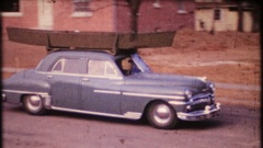 Fishermen haul their boat to lake on top of car, 3886 vintage film home movie Stock Footage