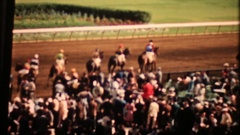 Crowd at thoroughbred racing action at Miami track, 3882 vintage film home movie Stock Footage