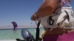 A woman preparing equipment to go kite surfing. Stock Footage