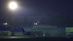 The plane with flashing sirens marker stands on the tarmac at night Stock Footage