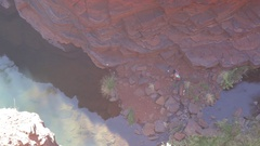Hiker at the bottom of a gorge in Karijini NP Stock Footage