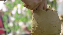 Close up clay doll making Stock Footage
