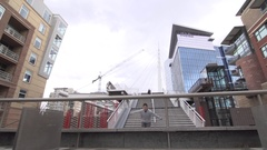 A young man freerunner doing parkour and jumping over railings in a city courtya Stock Footage