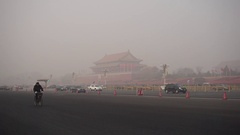 Man rides a bike past Tiananmen Rostrum in heavy haze Stock Footage