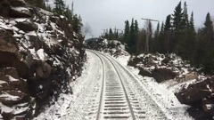 Train on Tracks Time Lapse Winter Forest Landscape Stock Footage