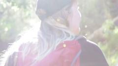Girl hiking through sunshine rays in Karijini NP Stock Footage