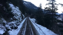 Train Time Lapse Through Tunnels in Snowy Winter Landscape Stock Footage