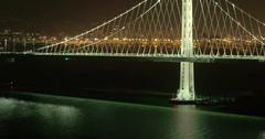 Aerial of San Francisco Bay Bridge at night Stock Footage