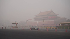 People walk past Tiananmen Rostrum, wearing mask in heavy haze Stock Footage
