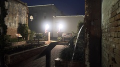 Night scene showing old brick architecture focus on water downspout 4k Stock Footage