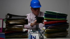 Engineer Working in Company Office Using Archive Information and Touch Tablet. Stock Footage