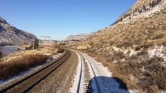 Train on Tracks Time Lapse Snowy Desert Winter Landscape Stock Footage