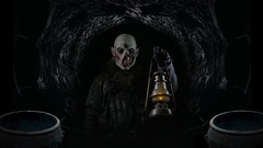 Orc stands watch in cave / mine with lantern  Stock Footage