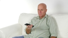 Smiling Mature Man Looking TV Search Entertainment Programs Use Remote. Stock Footage