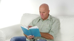 Relaxed Person Casual Dress Sit on Sofa and Read a Novel in Vacation Day. Stock Footage