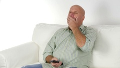 Tired Businessman Yawn Use a TV Remote Falling Asleep in Front of Television. Stock Footage
