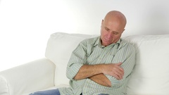 Tired Man Falling Asleep Standing on the Living Room Couch at Home. Stock Footage