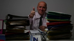 Businessman Working with Many Files in Office Room Make Thumbs Up Gesture. Stock Footage