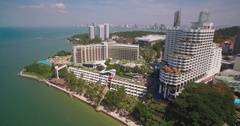 Resorts and Condos on Headland in Pattaya, Thailand, Descending Pan Shot Stock Footage