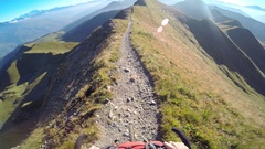 POV of a man mountain biking on a European mountainside. Stock Footage
