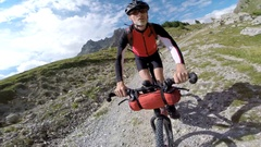 POV of a man mountain biking on a European mountainside biking trail. Stock Footage