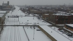 Aerial View Snow covered city buildings passenger train in snow Stock Footage
