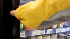 Woman picking Naked mighty mango juice inside London drugs store Stock Footage