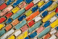 Multicolored painted bricks, exterior wall as background Stock Photos