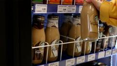Woman picking Starbucks frappuccino mocha inside London drugs store Stock Footage