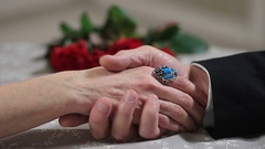 Senior male hand caressing elderly female hand Stock Footage
