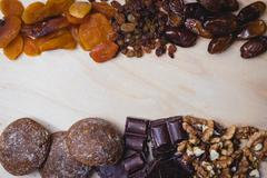 Composition of dried fruit, nuts, chocolate and home-made cakes Stock Photos