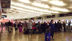 VIENNA, AUSTRIA - DECEMBER, 24 Steadicam shot of crowded airport terminal Stock Footage