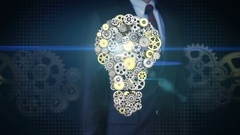 Businessman touching screen, big gears gathered idea bulb shape animation. Stock Footage