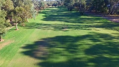 Aerial view of Golfers in Golf Buggy driving through Golf Course Stock Footage