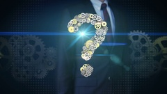 Businessman touching screen, Steel golden gears making question mark shape. Stock Footage