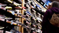 People comparing of exposition sport shoes inside sportchek store Stock Footage