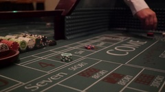 Dice being tossed on a craps table Stock Footage
