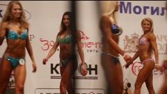 BELARUS. MOGILEV. 18 APRIL 2015. Slim female bodybuilder posing in bikini Stock Footage
