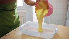 Woman making a cake Stock Footage