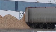Wood chips being unloaded from truck at paper mill Stock Footage