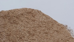Loader moving chips from pile at paper mill Stock Footage
