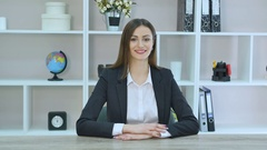 Smiling mature professional businesswoman in casual, with arms crossed standing Stock Footage