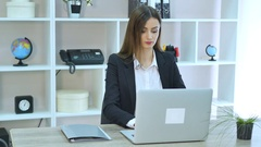 Side view of Business woman talking at phone and sitting by the table with Stock Footage