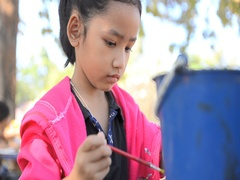 HD Close up shot asian little girl painting water color on the doll Stock Footage