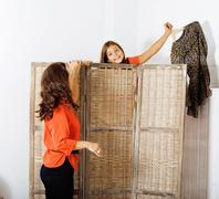 Happy mother with daughter trying on dresses at home interior, h Stock Photos