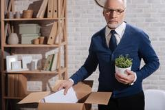 Hopeless professional clearing his workplace Stock Photos